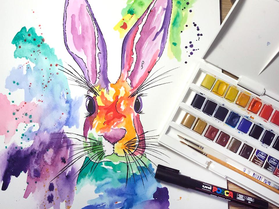 watercolour painting of a rabbit painted in rainbow colours